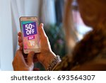 senior woman with a smartphone... | Shutterstock . vector #693564307