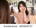 two girls making photos | Shutterstock . vector #693564727