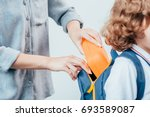 cropped shot of mother packing...   Shutterstock . vector #693589087
