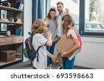 kids going to school and waving ... | Shutterstock . vector #693598663