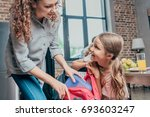 beautiful young mother giving... | Shutterstock . vector #693603247