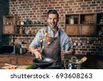 handsome young man with apron... | Shutterstock . vector #693608263
