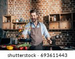 stylish young man with apron... | Shutterstock . vector #693611443