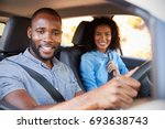 young black couple in a car on... | Shutterstock . vector #693638743