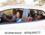 young black family in a car... | Shutterstock . vector #693639577