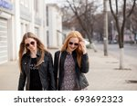 two friends hanging out in the... | Shutterstock . vector #693692323