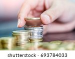 female hand stack euro coins to ... | Shutterstock . vector #693784033