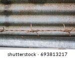 rust fence zinc background | Shutterstock . vector #693813217