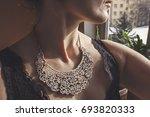 woman wearing ornamental... | Shutterstock . vector #693820333