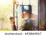 service man installing window...   Shutterstock . vector #693864967