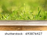 wooden table background   Shutterstock . vector #693876427