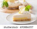 slice of cheesecake with lemon... | Shutterstock . vector #693886357