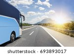 tourist bus rushes along the...   Shutterstock . vector #693893017