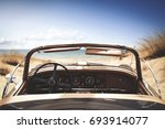 car on beach and summer time  | Shutterstock . vector #693914077