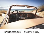 car on beach and summer time  | Shutterstock . vector #693914107