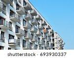 modern apartment building... | Shutterstock . vector #693930337