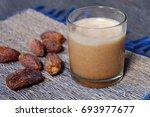single cup of dates juice  a... | Shutterstock . vector #693977677