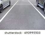 free space on parking lot. | Shutterstock . vector #693995503