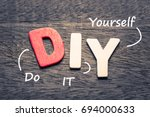 wood letters of diy and... | Shutterstock . vector #694000633