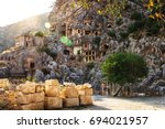 rock tombs in sunset light ... | Shutterstock . vector #694021957