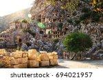 rock tombs in sunset light ... | Shutterstock . vector #694021957