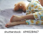 Small photo of Image of Bed-wetting situation in 4 or 5 years old girl.Girl wet the bed while she was sleeping.Selective focus