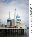Small photo of MAKASSAR, INDONESIA - August 11, 2017: Amir al Mukminin mosque is a floating mosque in the area of ??Losari Beach
