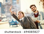 young tourists in the city... | Shutterstock . vector #694085827