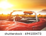 retro car on road and golden... | Shutterstock . vector #694100473