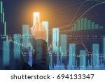 business man on digital stock... | Shutterstock . vector #694133347