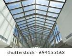 roof of modern shopping mall.... | Shutterstock . vector #694155163