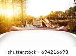 two lovers in retro car and... | Shutterstock . vector #694216693