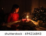 a girl blowing out the candle  | Shutterstock . vector #694216843