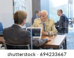 young financial advisor sitting ... | Shutterstock . vector #694233667