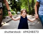 granddaughter with grandparents ... | Shutterstock . vector #694248373
