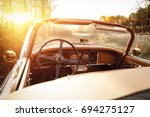 retro car in forest and golden... | Shutterstock . vector #694275127