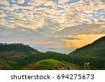 beautiful sunrise mountain on...   Shutterstock . vector #694275673