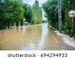 floods have flooded a street... | Shutterstock . vector #694294933