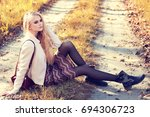 fashion portrait of young woman ... | Shutterstock . vector #694306723