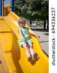 little girl on the playground... | Shutterstock . vector #694336237