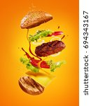 the hamburger with flying... | Shutterstock . vector #694343167