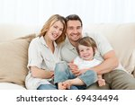 happy family on their sofa at... | Shutterstock . vector #69434494