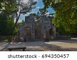 "Small photo of Temple de Diane, Nimes, France July 2017 Unidentified family and tourists visiting the ""Domanial park"" in Nîmes. The ""Temple of Diane"" is in this park"