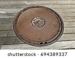 Round Manhole Lid Covering An...