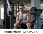 attractive man resting on bench ... | Shutterstock . vector #694397377