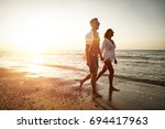 two lovers on beach and summer... | Shutterstock . vector #694417963