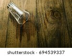 glass liquor spilled on the... | Shutterstock . vector #694539337
