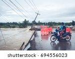 floods have flooded a street...   Shutterstock . vector #694556023