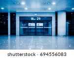 gate of airport terminal blue... | Shutterstock . vector #694556083