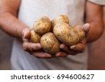 farmer holding in hands the...   Shutterstock . vector #694600627
